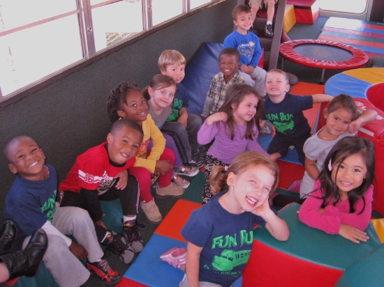 Kids Playing on the Fun Bus
