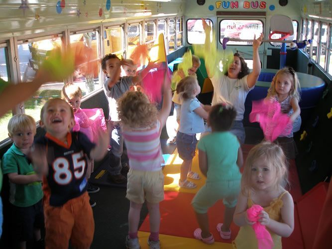 Kids Playing on the Fun Bus